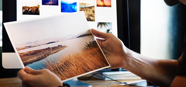 photographer-holding-landscape-printed-picture